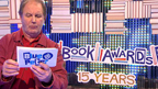 Michael Morpurgo sat on some books