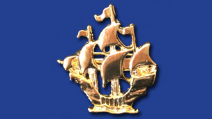 A gold Blue Peter badge