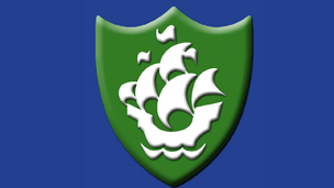 A green Blue Peter badge