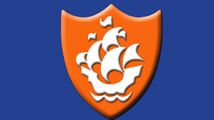 An orange Blue Peter badge
