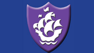 A purple Blue Peter badge