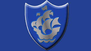 A silver Blue Peter badge