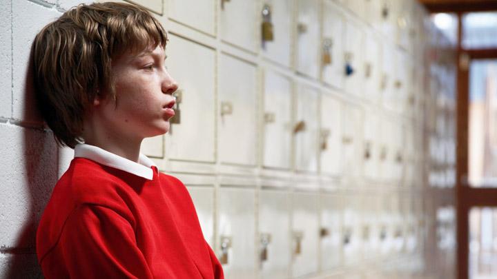 Boy looking sad at school.