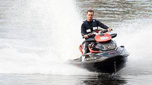 Blue Peter presenter Barney Harwood driving a jet ski