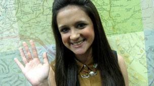 Amy-Leigh waving.