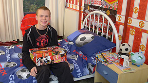 Frank in his Manchester United-themed bedroom.