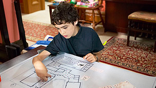 Gus planning the route to the toilet on a floor plan.