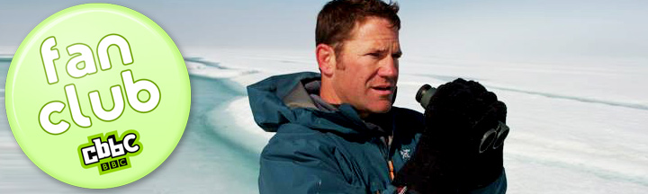 Steve Backshall looks through some binoculars