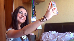Shannon taking a selfie with her phone.