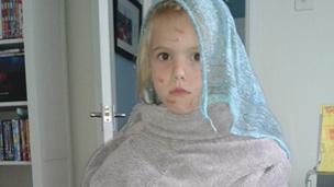 Ella as a peasant with the bubonic plague