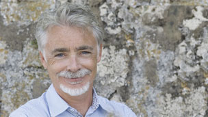 Artemis Fowl Author Eoin Colfer standing in front of a wall