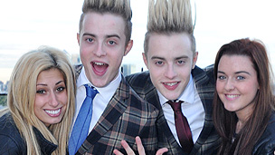 Jedward stand with two women looking excited