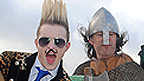 Jedward stand with 3 people in historic costume