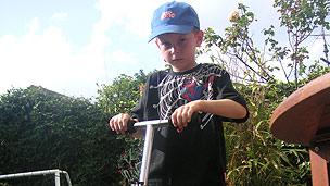 A boy on a scooter