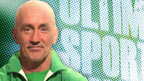 Barry McGuigan in front of the Irish flag.