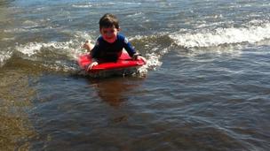 A boy on a body-board