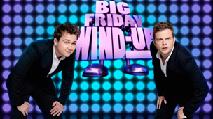 Sam and Mark in front on the Wind Up sign.
