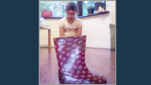 A girl that looks like she's inside a wellington boot