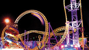 An illuminated theme park ride at night