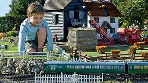 A model farm with a  tractor and farm-house.