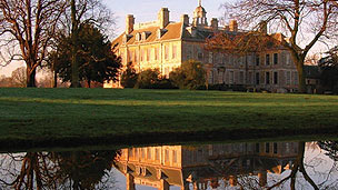 The outside of Belton House on an autumn day.