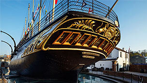 The ornate back end of Brunel's SS Great Britain. Black with golden patterns.