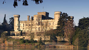Eastnor Castle surrounded by trees.