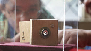 The world's first pinhole camera in a glass box.