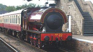 A steam train at a station