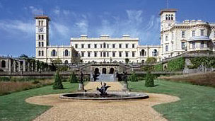 Osbourne House, a large white mansion with tall towers on the left and right of the building.