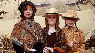 A group of children dressed up in Victorian clothing.
