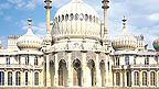 The exterior of The Royal Pavilion, a large, white ornate building that resembles the Taj Mahal.