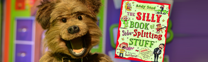 Hacker in the CBBC office, with the cover art for 'The Silly Book of Side-Splitting Stuff'.