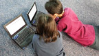 children looking at laptops