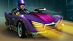 Tom drives a scary looking purple racing car in the woods.