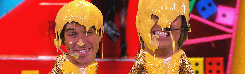 Diddy Dick and Dom wearing gold outfits covered in gunge.