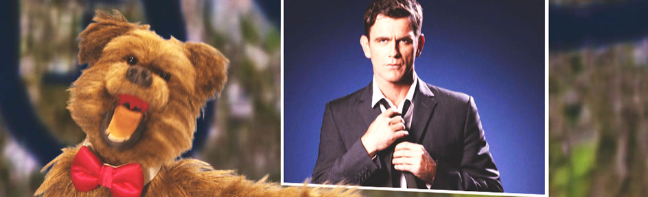 Hacker the Dog with a picture of Scott Maslen, who plays Jack Branning in Eastenders.