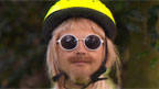 Mark Rhodes wears a cycle helmet, sunglasses, blonde wig and a high-vis vest.