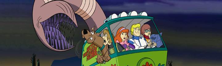 The gang in the Mystery Machine being chased unknowingly by a giant worm.