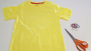 T-shirt turned inside out with scissors and rubber bands.
