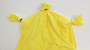 T-shirt with neck and arm holes banded closed