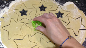 Smaller stars being cut out of the dough