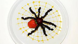 Finished tarantula on a web of golden syrup