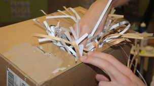 Shredded paper being put into the box