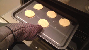 biscuits into oven