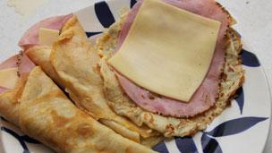 Savoury pancake being wrapped