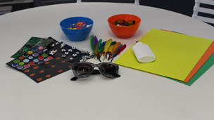 sunglasses, glue ande decorations on a table