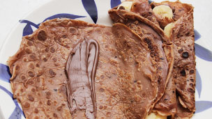 Chocolate pancake with a line of chocolate spread
