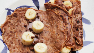 Chocolate pancake with a line of banana and chocolate