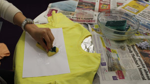 pressing the sponge onto the design paper